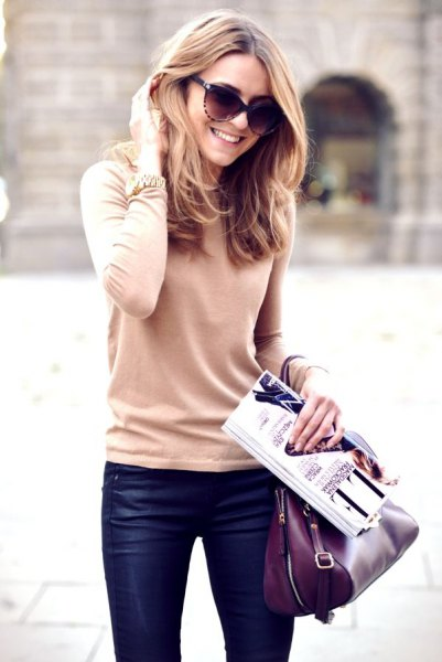 blushing pink sweater with dark blue waxed skinny jeans