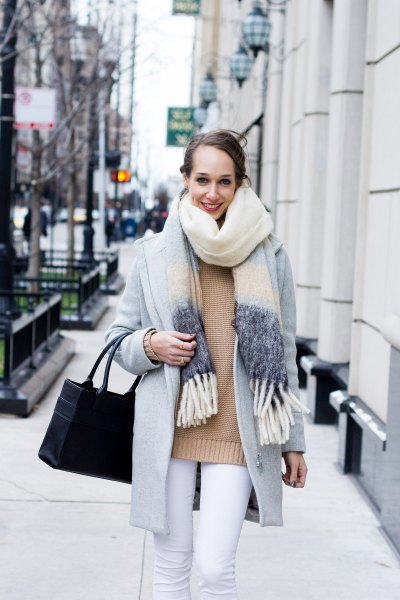 Blushing pink sweater with a light gray wool coat and white jeans