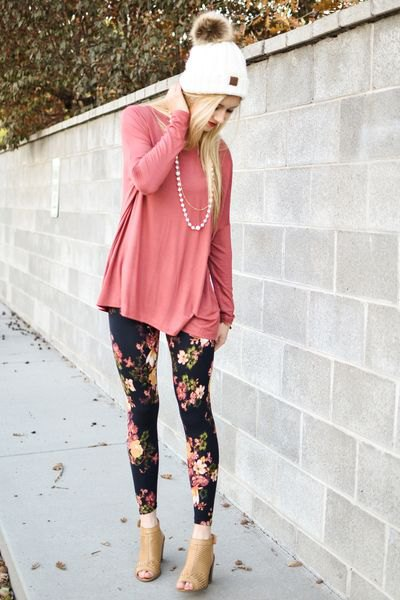 Blush pink t-shirt with floral patterned leggings and open toe boots