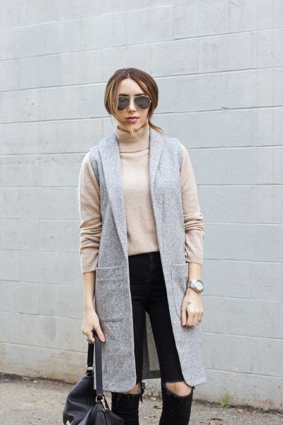 Blushing pink turtleneck with a gray longline vest