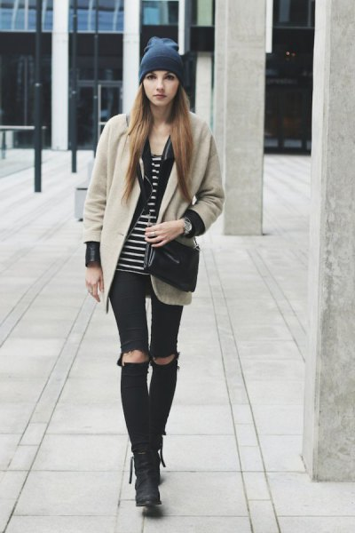 Blushing pink wool coat with a black and white striped tank top and torn knee jeans
