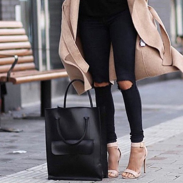 Blushing pink wool coat with black, ripped knee jeans