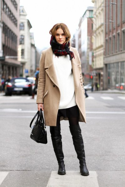 Blushing pink wool coat with a white tunic sweater and scarf