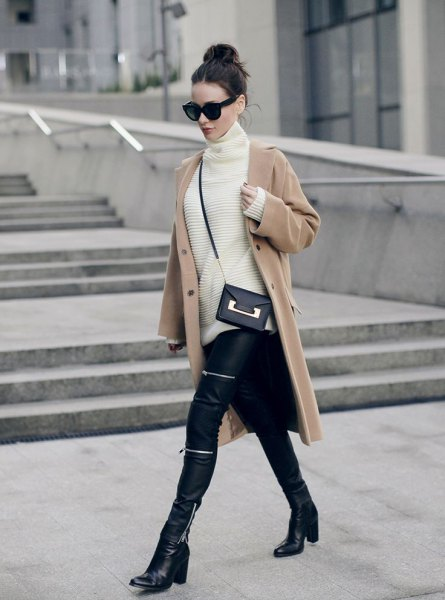 Blushing pink wool coat with a white turtleneck and biker pants