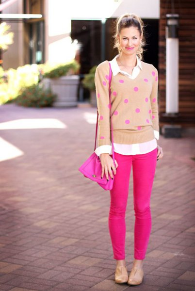 Blushing polka dot sweater with neon pink skinny jeans