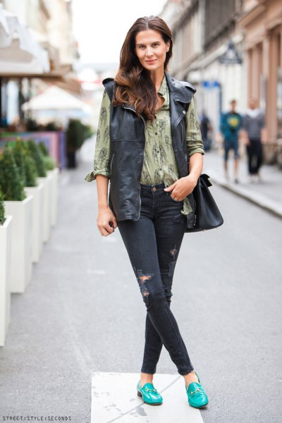 Blush printed blouse with button placket and oversized leather motorcycle vest