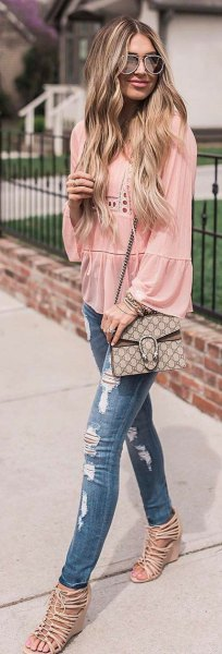 Blushing crochet blouse with puff sleeves, ripped jeans and strappy heels