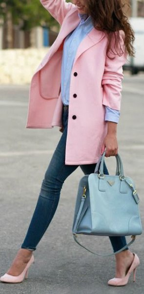 Blushing wool coat with a blue shirt with buttons and light pink pointed toe heels