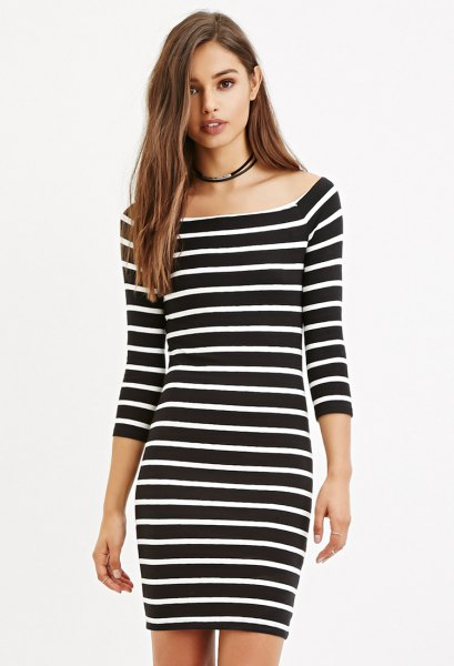 black and white striped bodycon dress with a boat neckline
