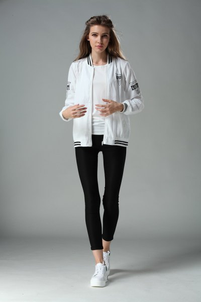 Bomber jacket with black, short leggings and white sneakers