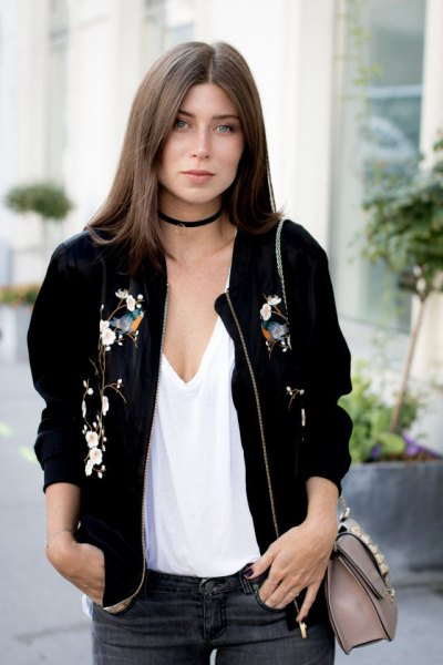 Bomber jacket with a low-cut white vest top and black collar