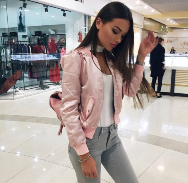 Bomber jacket with white tank top and gray skinny jeans