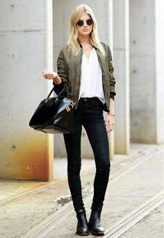 Bomber jacket with a white V-neck t-shirt and black skinny jeans