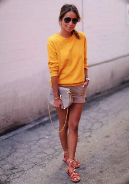 bright lemon yellow sweater with pink shorts and silver summer sandals