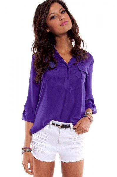 bright purple shirt with buttons and white mini-shorts