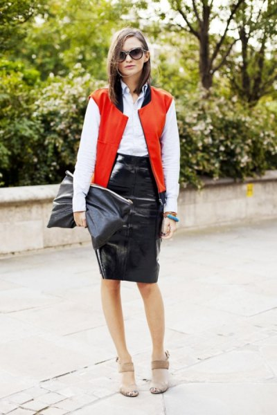 bright red sleeveless college jacket with white shirt with buttons and black leather skirt