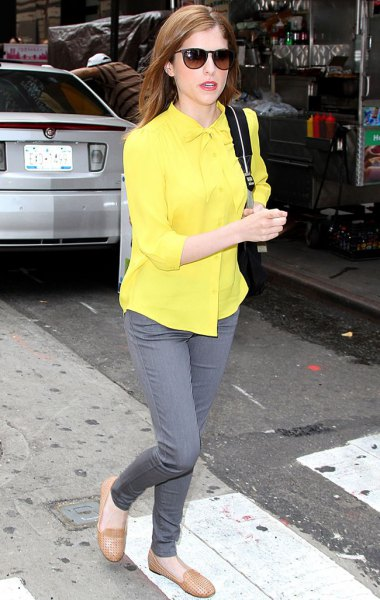 bright yellow shirt with buttons and gray, narrow-cut jeans