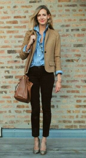 brown blazer with blue chambray shirt with buttons and black, cropped jeans