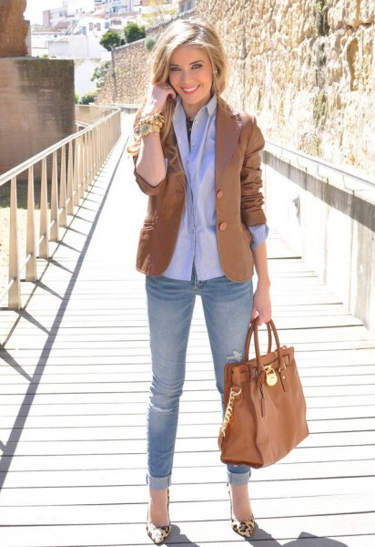 brown blazer with light blue shirt with buttons and jeans with cuffs
