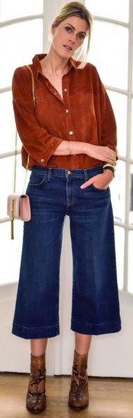 brown suede shirt with buttons and blue flared, cropped jeans