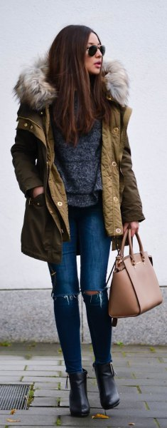 brown long-line bomber jacket with hood made of faux fur and ripped skinny jeans