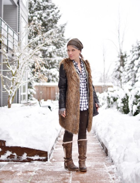 brown faux fur longline vest with black fleece leggings and a checked shirt