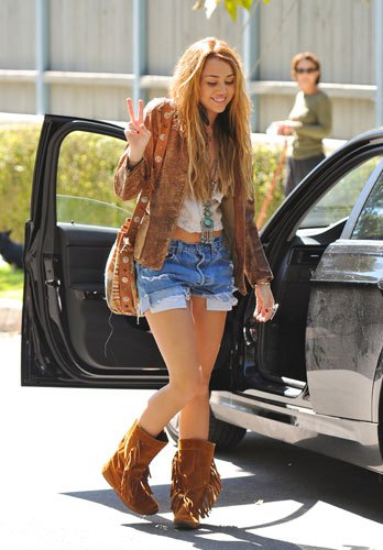 brown fringed boots denim shorts Miley Cyrus