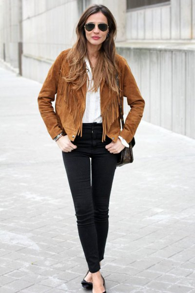 brown suede autumn jacket with fringes, white blouse and black jeans