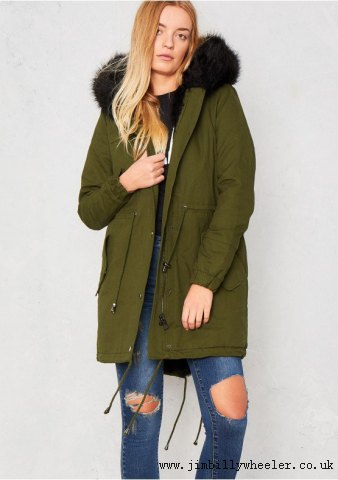 Parka coat with brown fur and ripped jeans