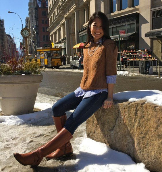 brown knitted sweater with half sleeves over a light blue chambray shirt