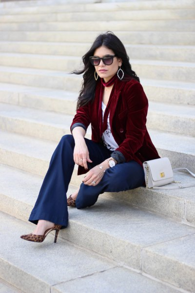 brown jacket with white t-shirt with scoop neckline and flared navy trousers