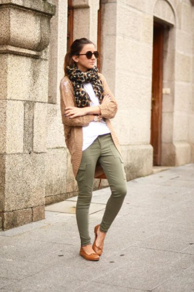 brown cardigan with scarf with leopard print and green khaki drainpipe trousers