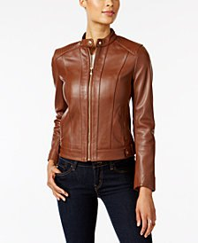 brown leather aviator jacket with black skinny jeans