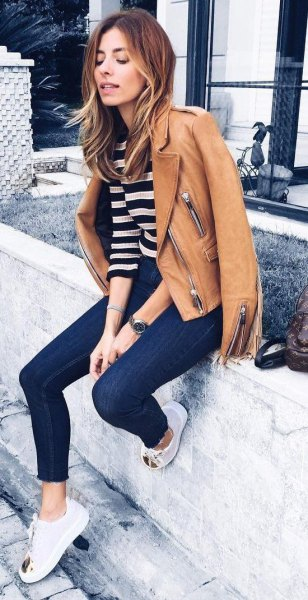 brown leather jacket with black and white wide striped sweater