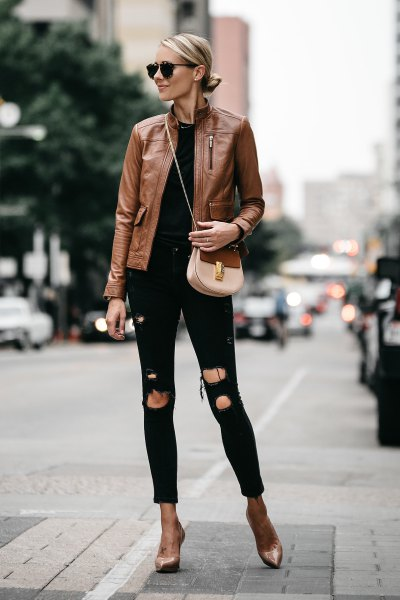 brown leather jacket with black skinny jeans