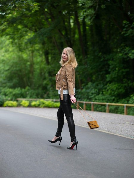 brown leather jacket with black thin biker pants