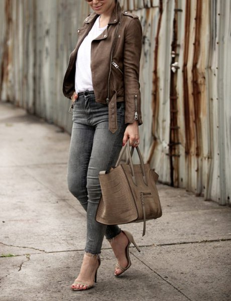 brown leather jacket with gray skinny jeans