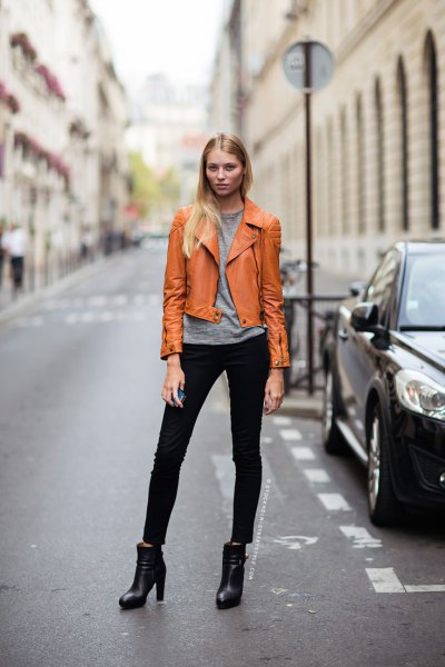 brown leather jacket with gray t-shirt and black skinny jeans