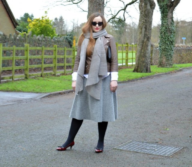 brown leather jacket with gray wool scarf and matching midi skirt