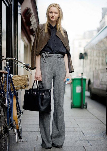 brown leather jacket with heather gray knit pants with wide legs