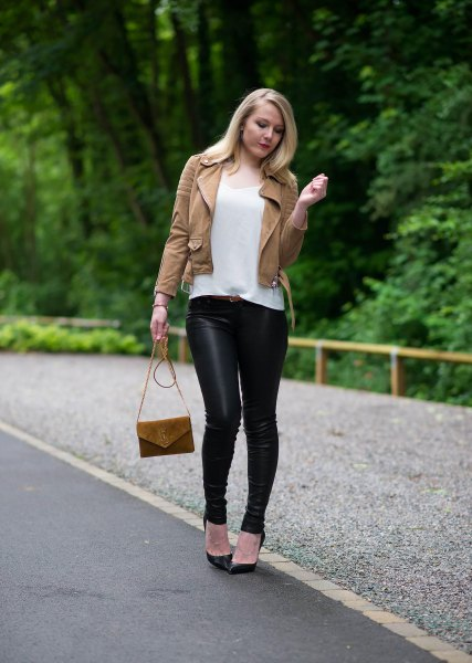 brown leather jacket with white t-shirt with scoop neck and black leggings