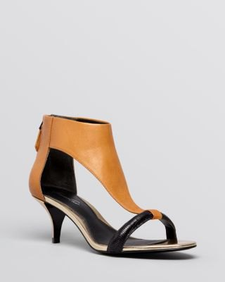 brown leather sandals with kitten heel, black mini fit and flared dress