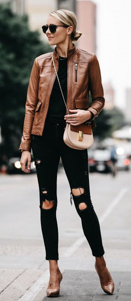 brown leather motorcycle jacket with ripped black skinny jeans with cuffs