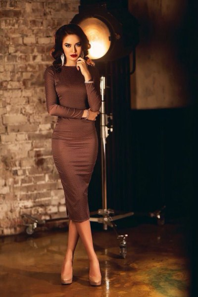 brown, long-sleeved, figure-hugging midi dress with light pink platform heels