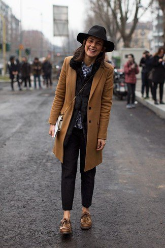 brown longline blazer with black slim fit trousers and floppy hat