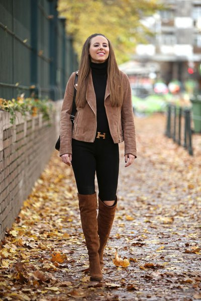 brown matte leather jacket with black jeans and high camel boots