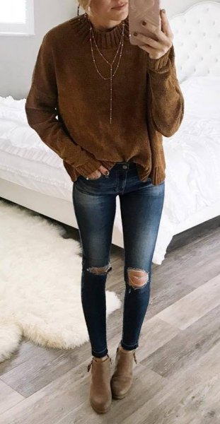 Chunky knit sweater with brown mock neck and blue skinny jeans