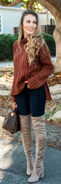 brown ribbed sweater with stand-up collar and gray, thigh-high boots