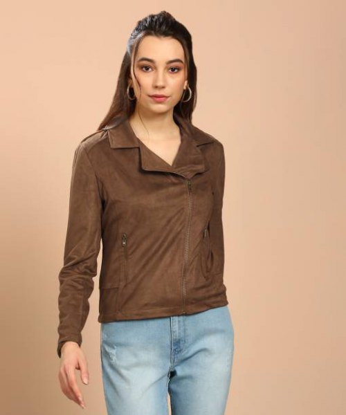 brown nylon sports jacket with light blue jeans