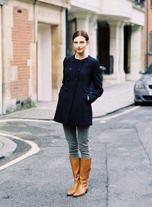 brown riding boots dark blue coat